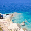 Sea scene with transparent water and rocky coast on Crete island — Stock Photo #53344973