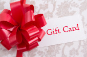 Gift box with big bow and gift card — Stock Photo