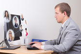 Social network concept - young business man working in office — Stock Photo