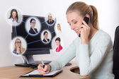 Social network concept - businesswoman talking on the phone in o — Stock Photo