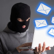 Hacker stealing data from laptop or sending spam messages — Stock Photo #54251851