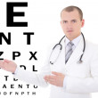 Young male doctor ophthalmologist and eye test chart isolated on — Stock Photo #54251939