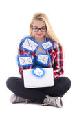 Young blondie woman sitting with laptop and sending messages iso — Stock fotografie