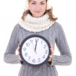 Happy beautiful woman in winter clothes with clock isolated on w — Stock Photo #54469001