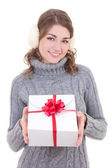 Happy attractive woman in woolen sweater and muffs holding gift  — Photo