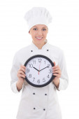Young woman chef in uniform holding office clock isolated on whi — 图库照片