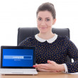 Beautiful business woman sitting in office and showing laptop wi — Stock Photo #56167061