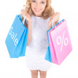 Sale concept - funny girl in white dress with shopping bags isol — Stock Photo #56886197