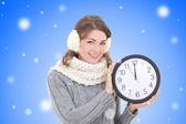 Happy beautiful woman in winter clothes holding office clock ove — Stock Photo