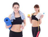 Two happy slim women with yoga mat, towels and bottles of water  — Foto de Stock