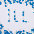 Ill word text made of blue tablets, pills and capsules — Stock Photo #59587123