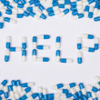 Help word text made of blue tablets, pills and capsules — Stock Photo #59587149