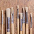 Wooden paint brushes on table background — Stock Photo #59886967