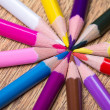 Close up of many colorful drawing pencils on wooden table — Stock Photo #60324525