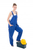 Portrait of young attractive woman builder in blue workwear with — Stock Photo