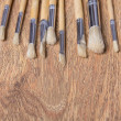 Paint brushes on wooden table background — Stock Photo #61609987