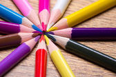 Close up of many colored drawing pencils on wooden table — Stock Photo