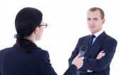Female reporter with microphone taking interview and business ma — Stock Photo