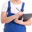 Close up of man builder in blue uniform writing something in cli — Stock Photo #62655987