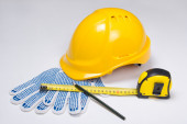 Builder's tools - helmet, work gloves, pen and measure tape  ove — Stock Photo