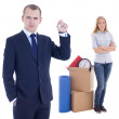 Moving day concept - handsome business man with key and young wo — Stock Photo #63373875