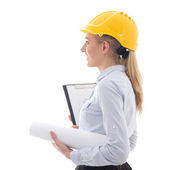 Side view of dreaming business woman architect in builder helmet — Stock Photo