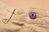 Close up of button on pants — Stock Photo