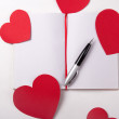 Love letter concept - note book, pen and paper hearts — Stock Photo #66270153