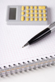 Business concept - note book with checked pages, pen and calcula — Stock Photo