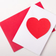 Love concept - handmade card with red paper heart over white — Stock Photo #67299169