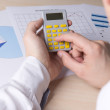 Man accounting something with calculator — Stock Photo #67320939