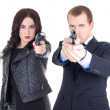 Young attractive woman and handsome man posing with gun isolated — Stock Photo #68344107
