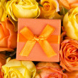 Beautiful bouquet of roses and little gift box — Stock Photo #68548501