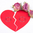 Divorce concept - wedding rings on red broken heart with dry flo — Stock Photo #68548691