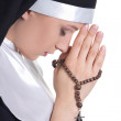 Portrait of young beautiful woman nun praying with rosary isolat — Stock Photo #68899851