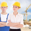 Man builder and business woman architect in helmet — Stock Photo #69891251