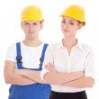 Young man builder and business woman architect in helmet isolate — Stock Photo #69891281