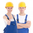 Young man and woman in builder 's uniform isolated on white — Stock Photo #69891349