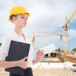 Business woman architect in yellow builder helmet  — Stock Photo #69891465