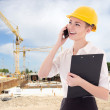 Young beautiful business woman architect in builder helmet talki — Stock Photo #69891491