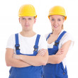 Young man and woman in blue builder 's uniform isolated on white — Stock Photo #69891575