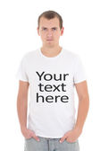"""Young man in white t-shirt with """"your text here"""" isolated on whi — Stock Photo"""