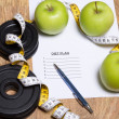 Diet plan concept - apples, measure tape and dumbbell — Stok fotoğraf #71651013