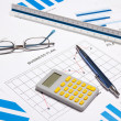 Business objects - graphs, charts, pen and calculator — Stock Photo #71651235