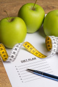 Diet concept - paper with diet plan, apples and measure tape on — Stock Photo