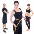 Weight loss concept - young people in sports wear isolated on wh — Stock Photo #72107225