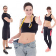 Weight loss concept - young woman after diet with her trainers i — Stock Photo #72107231