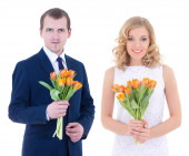 Holiday concept - young man and woman with tulips in hands isola — Stock Photo