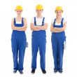 Team work concept - man and two women in builders uniform isolat — Stock Photo #72620369