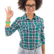 Smiling beautiful african american teenage girl showing ok sign — Stock Photo #73010367